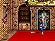 Girl hanging from wall in Double Dragon arcade