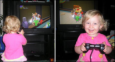 Little girl playing katamari Damacy