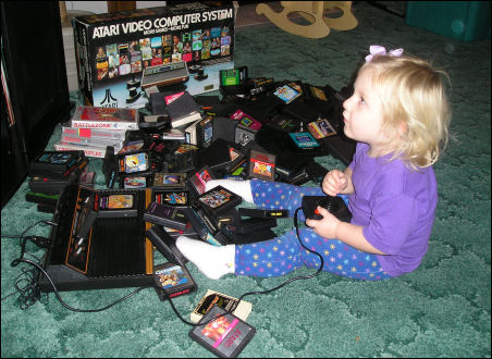 Little girl playing jungle hunt on the Atari 2600