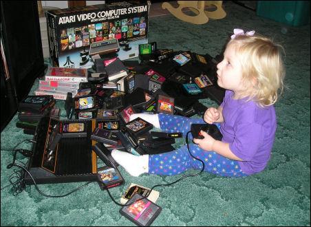 Little girl playing jungle hunt on the Atari 2600